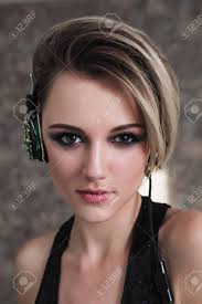 lovely with tanned skin and white hair listening to on headphones female beauty