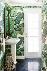 this is how a designer makes a tiny bathroom look luxe in 2019 bathrooms powder rooms bathroom wallpaper tropical bathroom tropical wallpaper