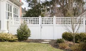 to paint a wooden fence with a sprayer