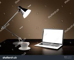 computer generated image of laptop desk lamp and cup of coffee in dark room