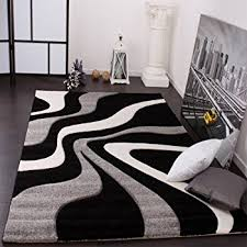 black and white rug. designer rug with contour cut waves pattern black grey white 200x290 cm and o