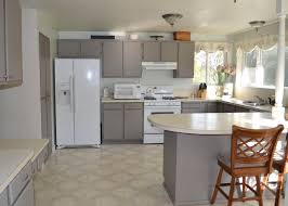 pretty gray oak wood formica kitchen cabinets features white color wooden laminated countertops and white built in stoves oven and double bowl stainless