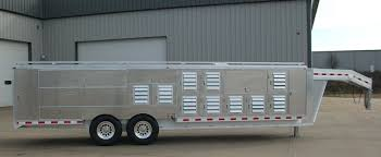 Tandem axle gooseneck dog trailer. It has 20 crates for dogs, & 14 storage  compartments. It also has room for a ATV and water storage.