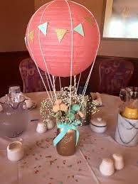 a c hot air balloon and flowers in a mason jar