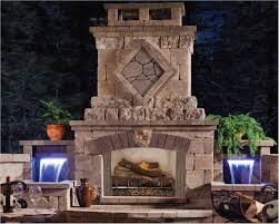 amazing outdoor stone fireplace with built in waterfall feature