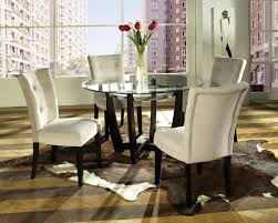 pretty dining room chair covers. pretty ivory parsons chairs with black wooden legs and round glass dining table for room chair covers