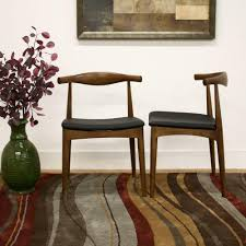 baxton studio sonore black faux leather upholstered and dark brown wood dining chairs set of