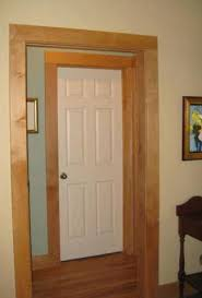white door with wood trim white interior doors with dark wood trim