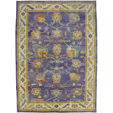 contemporary turkish oushak rug with modern style and purple field