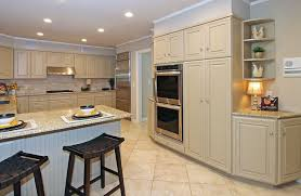 traditional cream cabinet kitchen with white quartz countertop