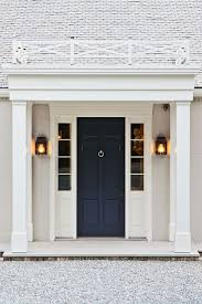 Dark blue #FrontDoor contrasting nicely with the white house