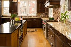 new countertops dark cabinets light wood flooring new venetian gold granite grace