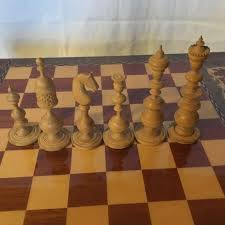 chess table including box with very beautiful hand carved wooden chess pieces