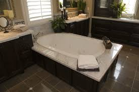large soaking tub. Unique Large Large Soaking Tub Rests On Marble Topped Dark Wood Enclosure Between  Matching Vanity Counters Intended Soaking Tub T