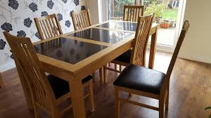 solid oak black granite dining room table with 6 chairs