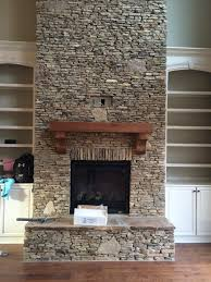 this is the kitchen wall needing a backsplash it faces the fireplace at the opposite end of a very long room off the side of that long living kitchen