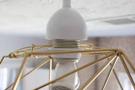forming a small loop around the existing wires see photo for gui snip any excess wire off with your wire cutters diy geometric pendant light
