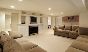 cinema room furniture. Minimalist Basement Finishing Ideas For Home Cinema Room Decorated With Beige Fabric Sofa And White Cabinet Furniture