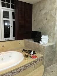 eastern oriental hotel tv at side of spa bathtub in bathroom e o suite