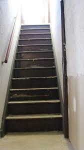 Steep narrow basement stairs