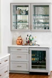 gray kitchen bar with glass door beverage fridge