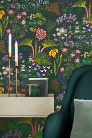 A stunning wallpaper design featuring bright flowers, leaves and rhubarb  plants on a dark green