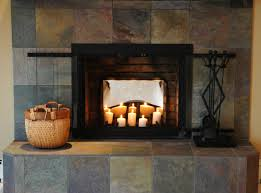 lovely fireplace candelabra with tile wall and floor for warm room decoration ideas