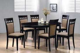 black round dining table and 6 chairs