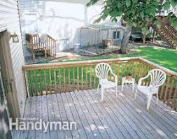 Privacy deck rail Diy Deck And Railing Before The Fence Yourtechclub Build Deck Privacy Fence The Family Handyman