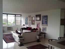 Organizing Living Room Tips On Arranging And Organizing Artwork In A Beautiful City View