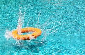 pool splash. Lifebuoy Splash The Water In Pool Stock Photo - 21956638 O