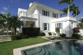 View in gallery Classic stucco home with Caribbean style