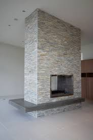 gas fireplace stone veneer finish with a cantilevered polished concrete hearth custom built stainless