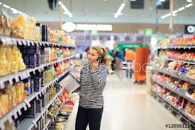 Grocery Store Product List Woman Shopping In Supermarket Reading Product Information Checking