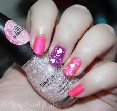 sinful colors valentine s day manicure with hearts using sinful colors love sprinkles daredevil