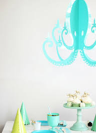 i love this turquoise octopus chandelier it looks so pretty
