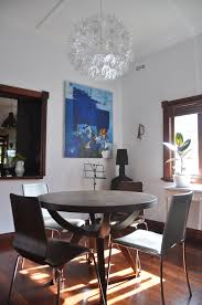west elm arc base pedestal table and white walls in the dining room