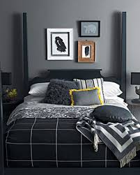 black and gray bedding with golden yellow cushion for modern bedroom  decorating