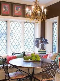 bohemian breakfast nook with chandelier and graphic throw pillows