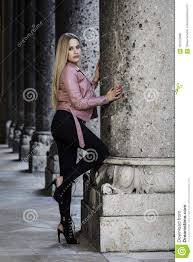 blonde woman wearing black jeans and leather jacket