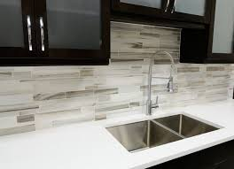 modern kitchen tiles. Fine Modern A Modern Kitchen In Black And White The Contrast Is Softened By The Long  Tile Backsplash Shades Of Gray Taupe Throughout Modern Kitchen Tiles