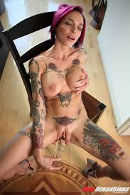 Shaved Babe with Pierced Pussy Playing With Dildo Image Gallery.