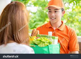 Asian Online Grocery Store Asian Delivery Man Delivering Food Woman Stock Photo Edit Now