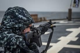 Us Navy Gunners Mate 2nd Class Perron Fires An M16 Rifle During A