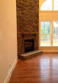 corner stone fireplace corner fireplace ideas modern room high ceiling round stacked stone best images about