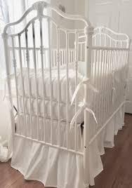 white ruffled crib set