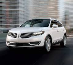 2018 lincoln suv models. interesting models a 2018 lincoln mkx drives through a city at sunset with lincoln suv models