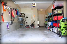 before small diy garage makeover with concrete floor steel rack shelving plastic box storage and hanging storage on the wall ideas