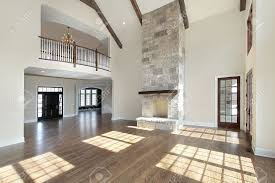 great room with fireplace. huge great room with stone fireplace and balcony stock photo - 6732424 a