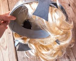 detail of inside of the helmet showing how the hair was glued to the inside of